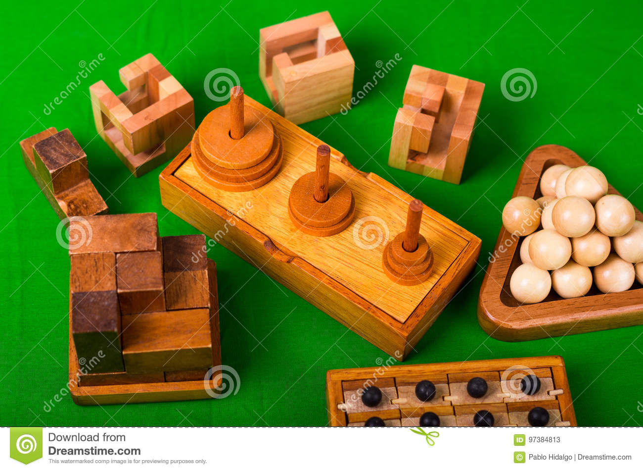 Assorted Wooden Brain Teaser Or Wooden Puzzles On Green