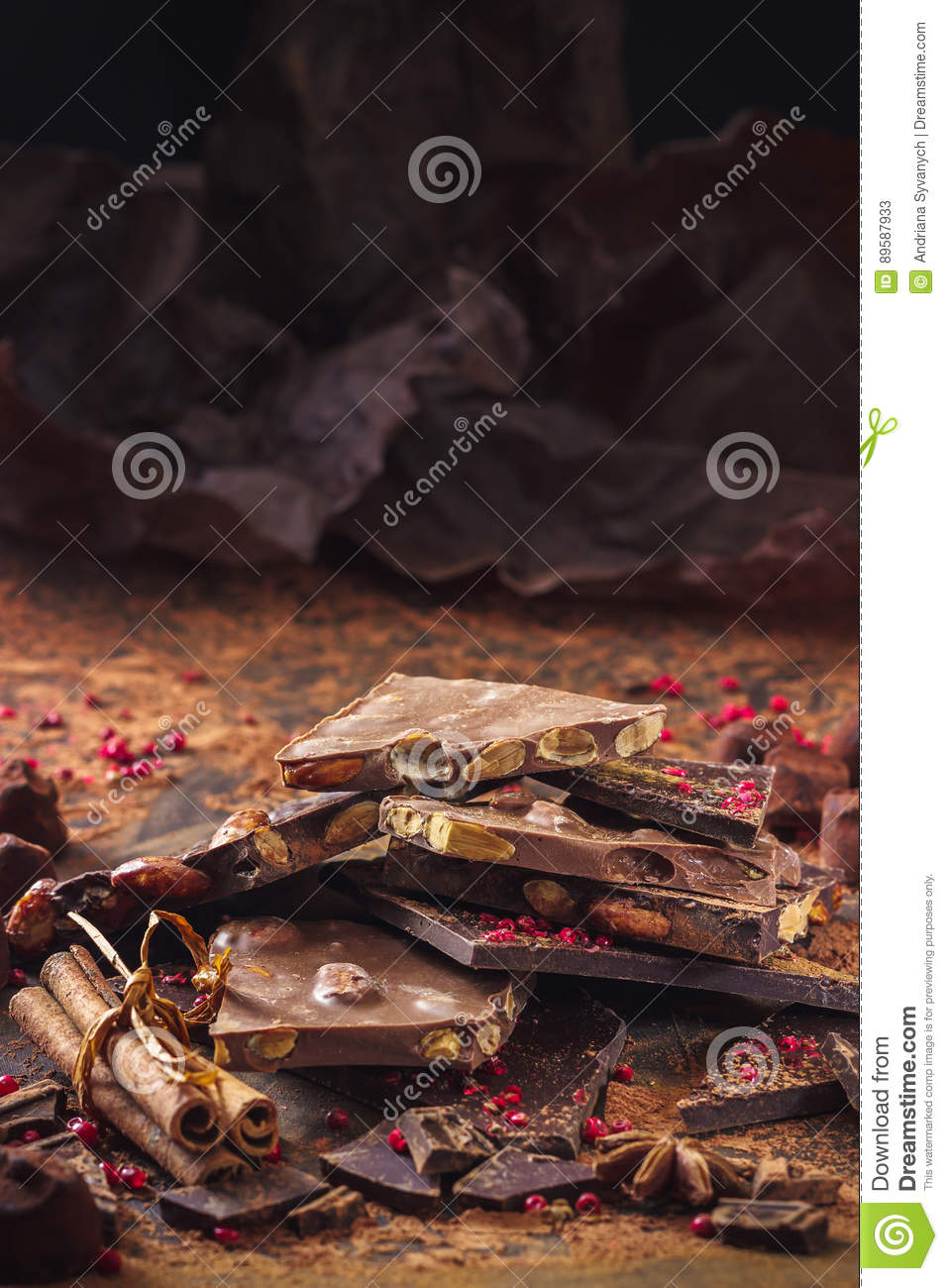 Assortment of chocolate bars, truffles, spices and cocoa powder