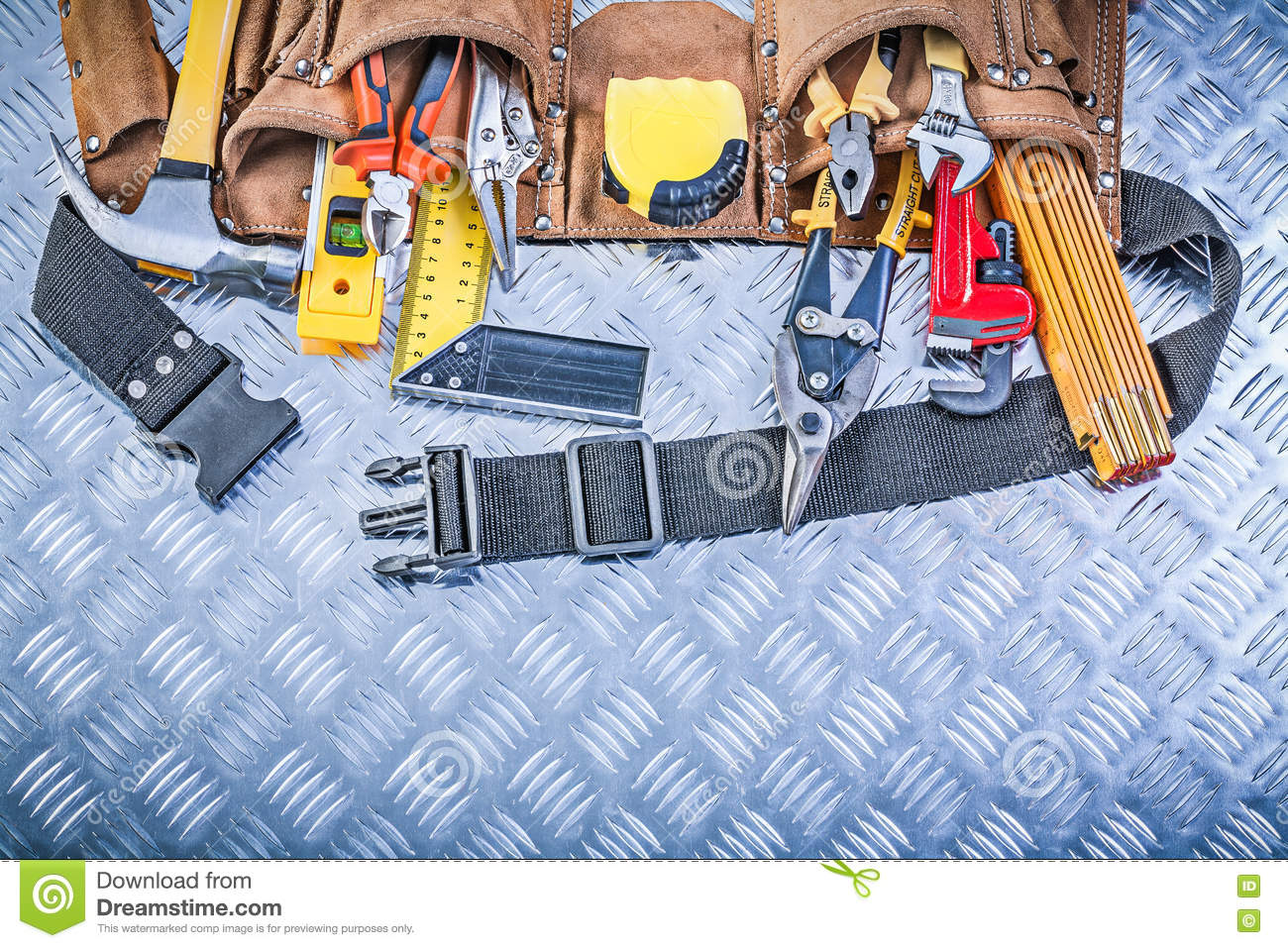 Assortment of construction tooling in leather building belt on c
