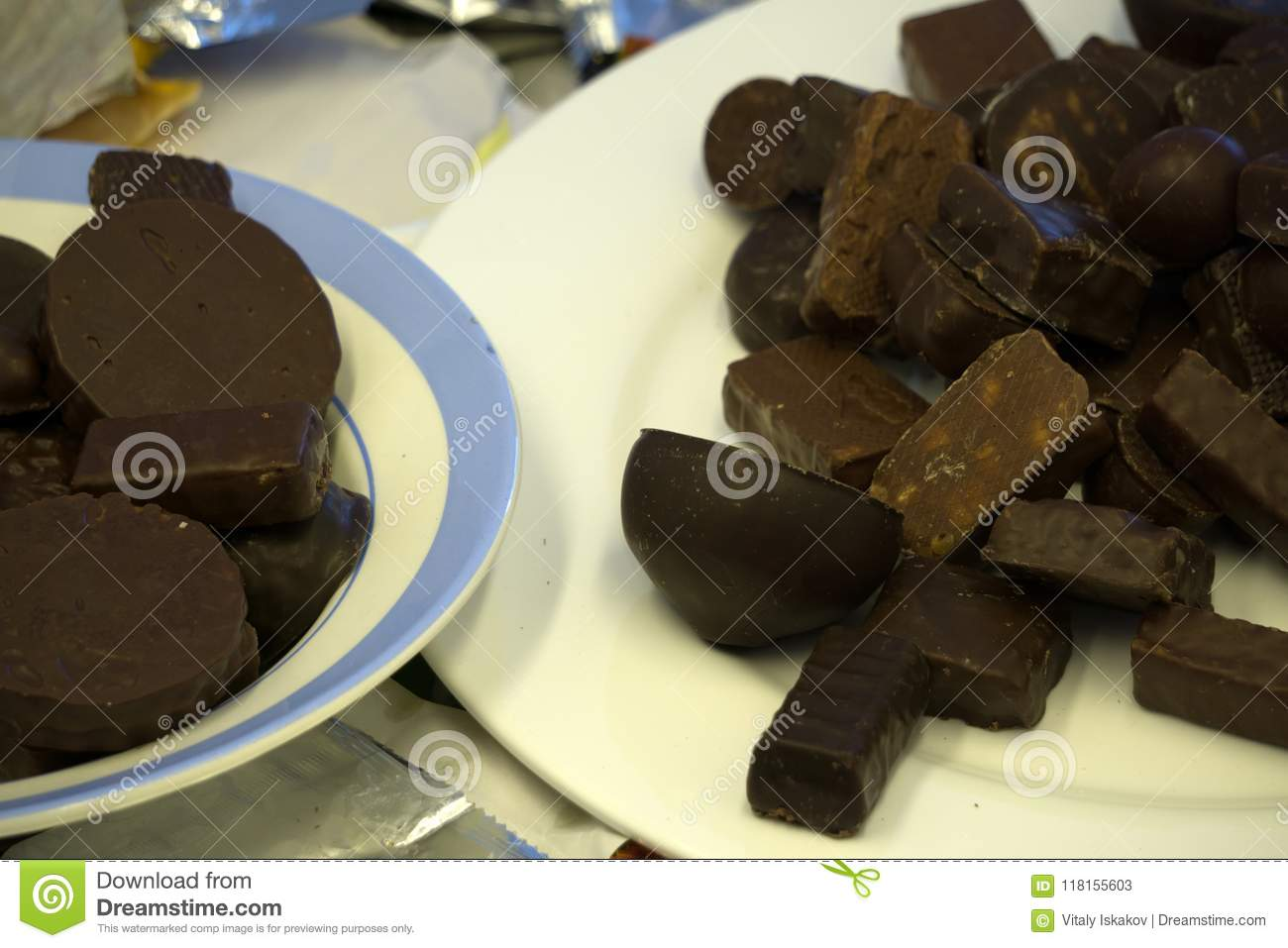 Assortment of dark, white and milk chocolate stack, chips. Chocolate and coffee beans on rustic wooden sacking background. Spices,
