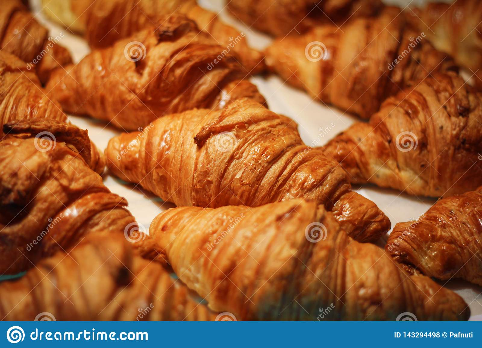Assortment of delicious and chocolate croissants made by pastry chef.