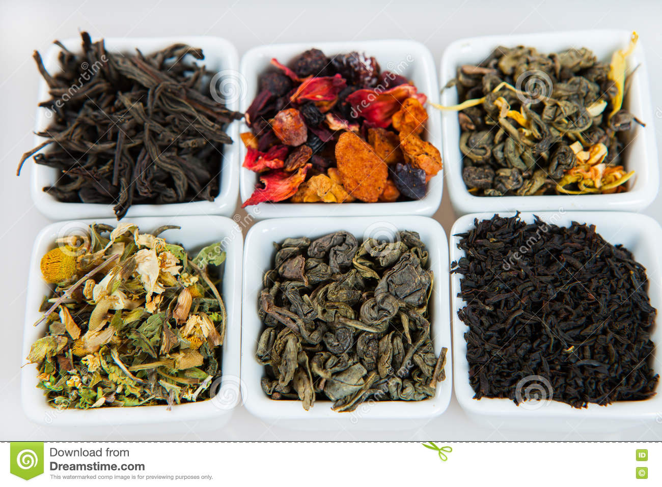 Assortment of dry tea. Various kinds of tea isolated on white.Different kinds of tea leaves. Tea composition with different kind