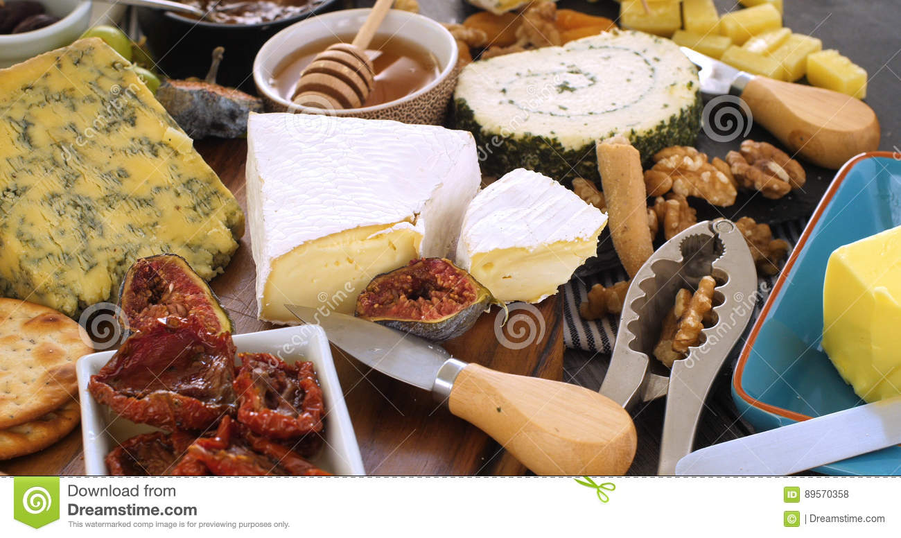 Assortment Of French And British Cheese With Figs And