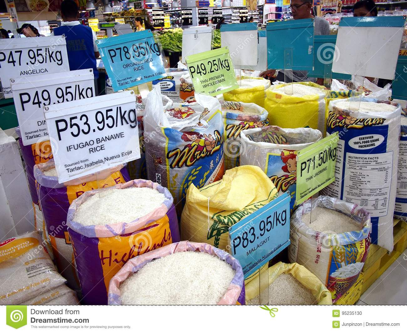An assortment of fresh uncooked commercial rice on sale at a grocery store.