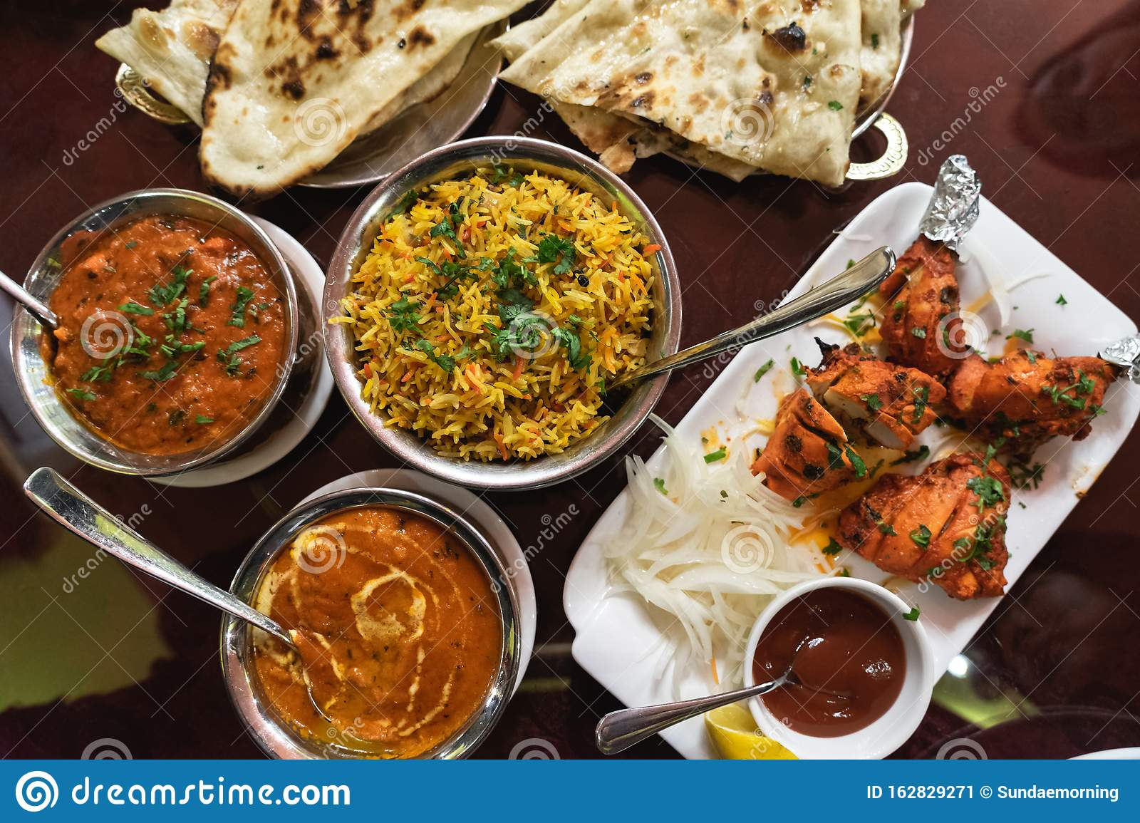 Assortment Of Indian Dishes For Dinner Butter Chicken Tikka Masala Rice And Naan Stock Image Image Of Cooking Children 162829271