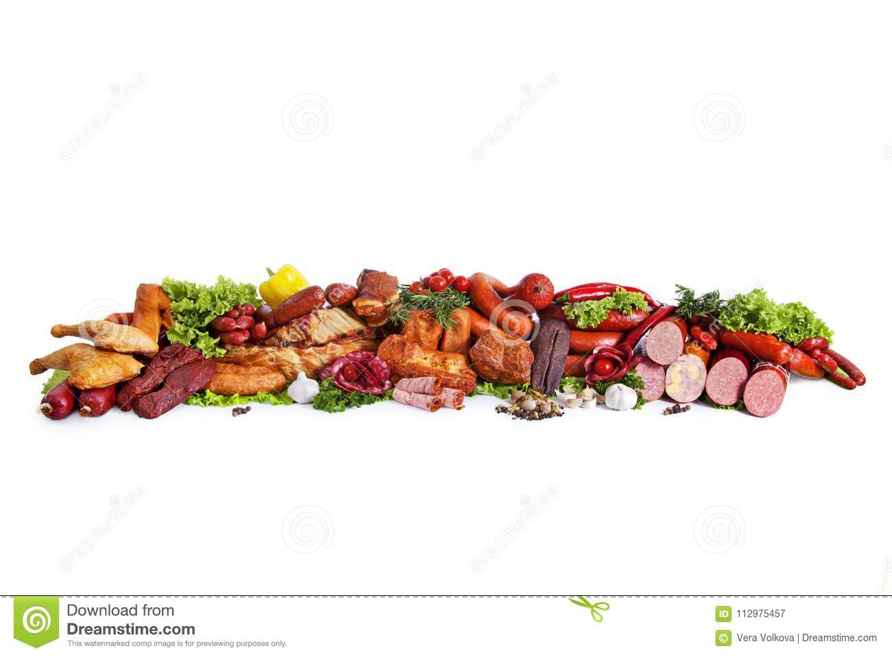 Assortment of smoked products. Decorated with vegetables and leaves of green salad. Isolated on white background