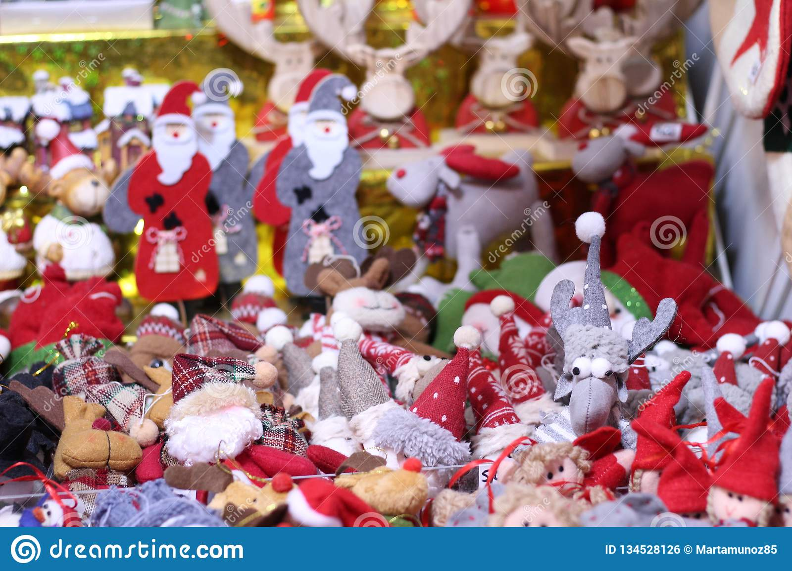 Assortment of toy decoration for the Christmas tree in baskets in store
