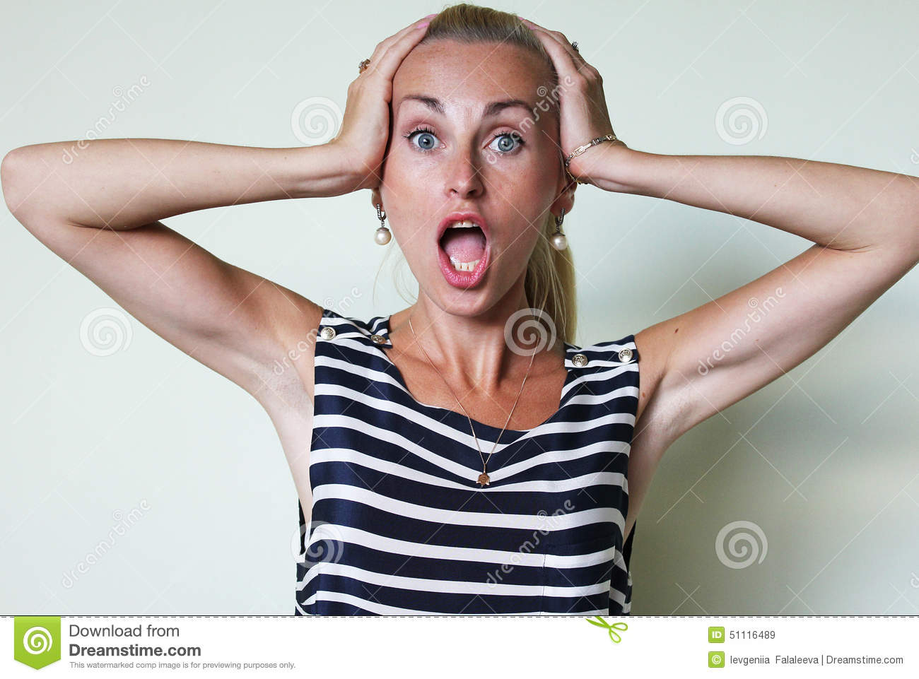 An astonished woman with open mouth