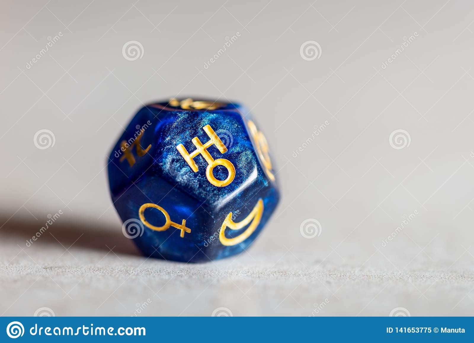 Astrology Dice with symbol of the planet Saturn