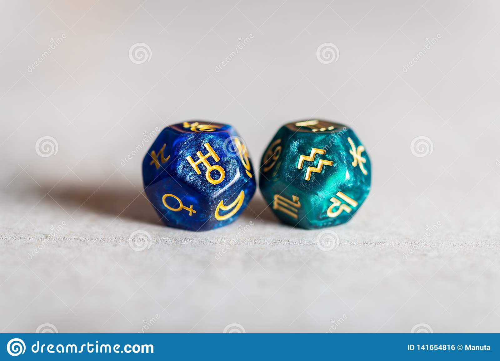Astrology Dice with zodiac symbol of Aquarius and its ruling planet Uranus