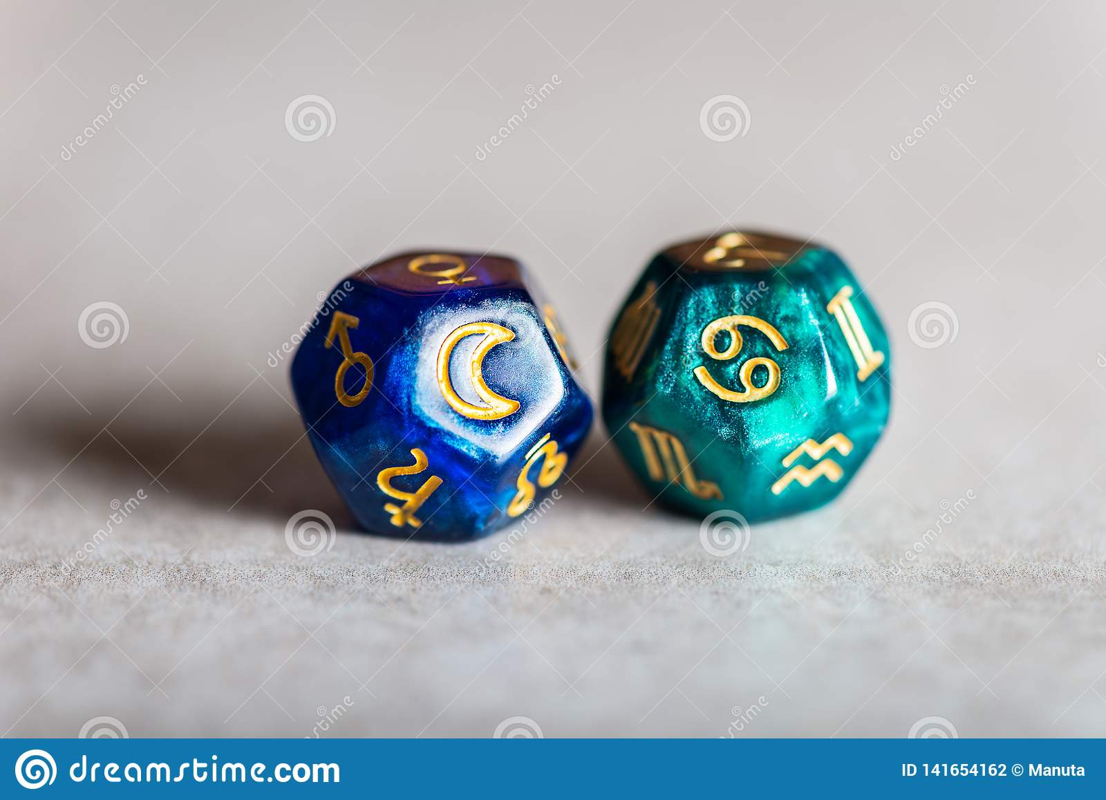 Astrology Dice with zodiac symbol of Cancer and its ruling celestial body the Moon