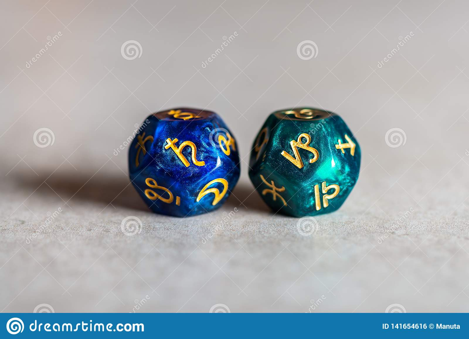 Astrology Dice with zodiac symbol of Capricorn and its ruling planet Saturn