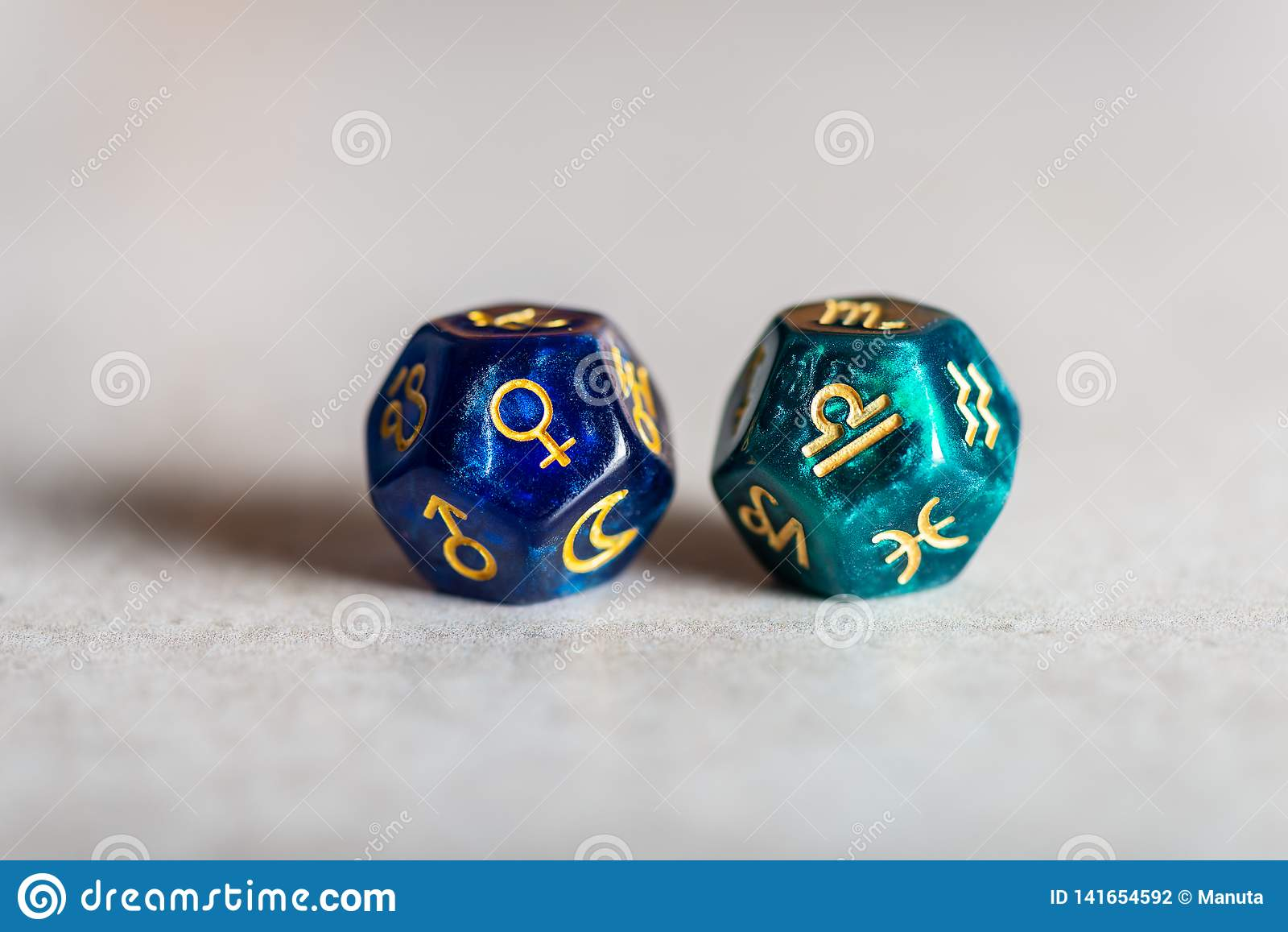 Astrology Dice with zodiac symbol of Libra and its ruling planet Venus