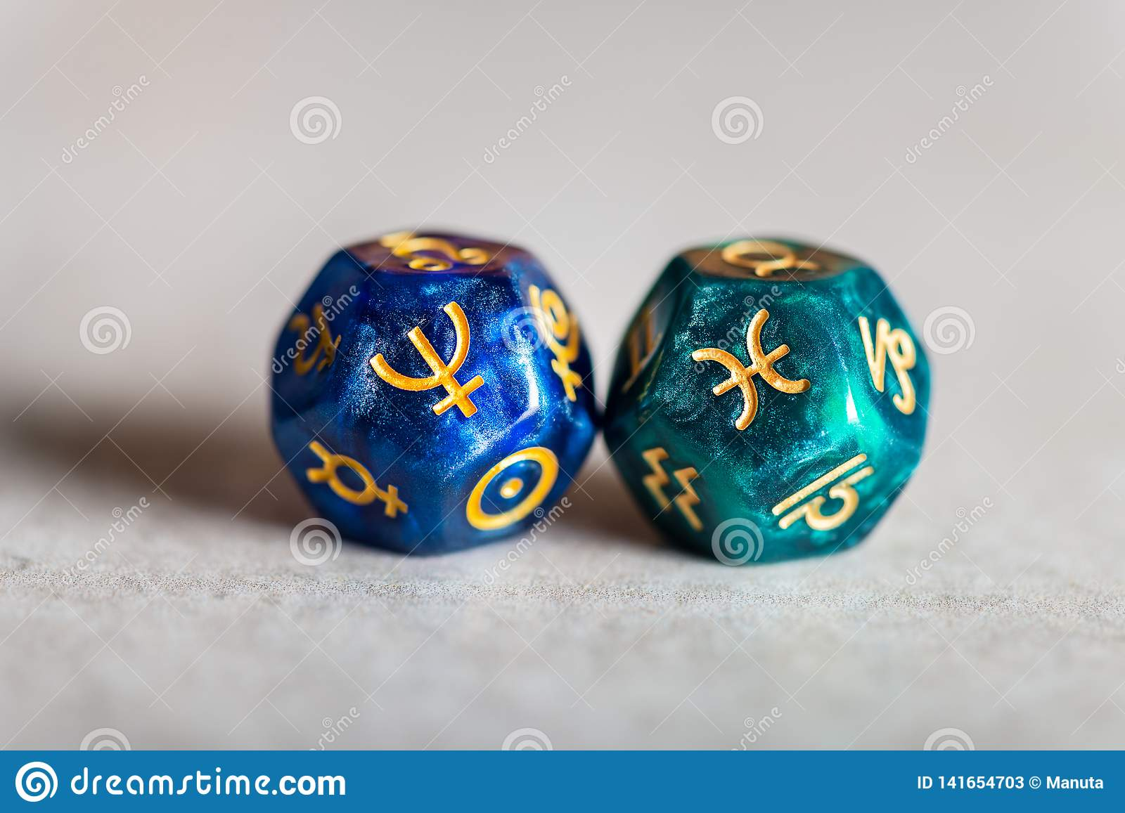 Astrology Dice with zodiac symbol of Pisces and its ruling planet Neptune
