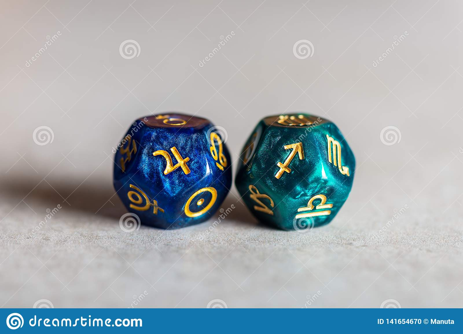 Astrology Dice with zodiac symbol of Sagittarius and its ruling planet Jupiter