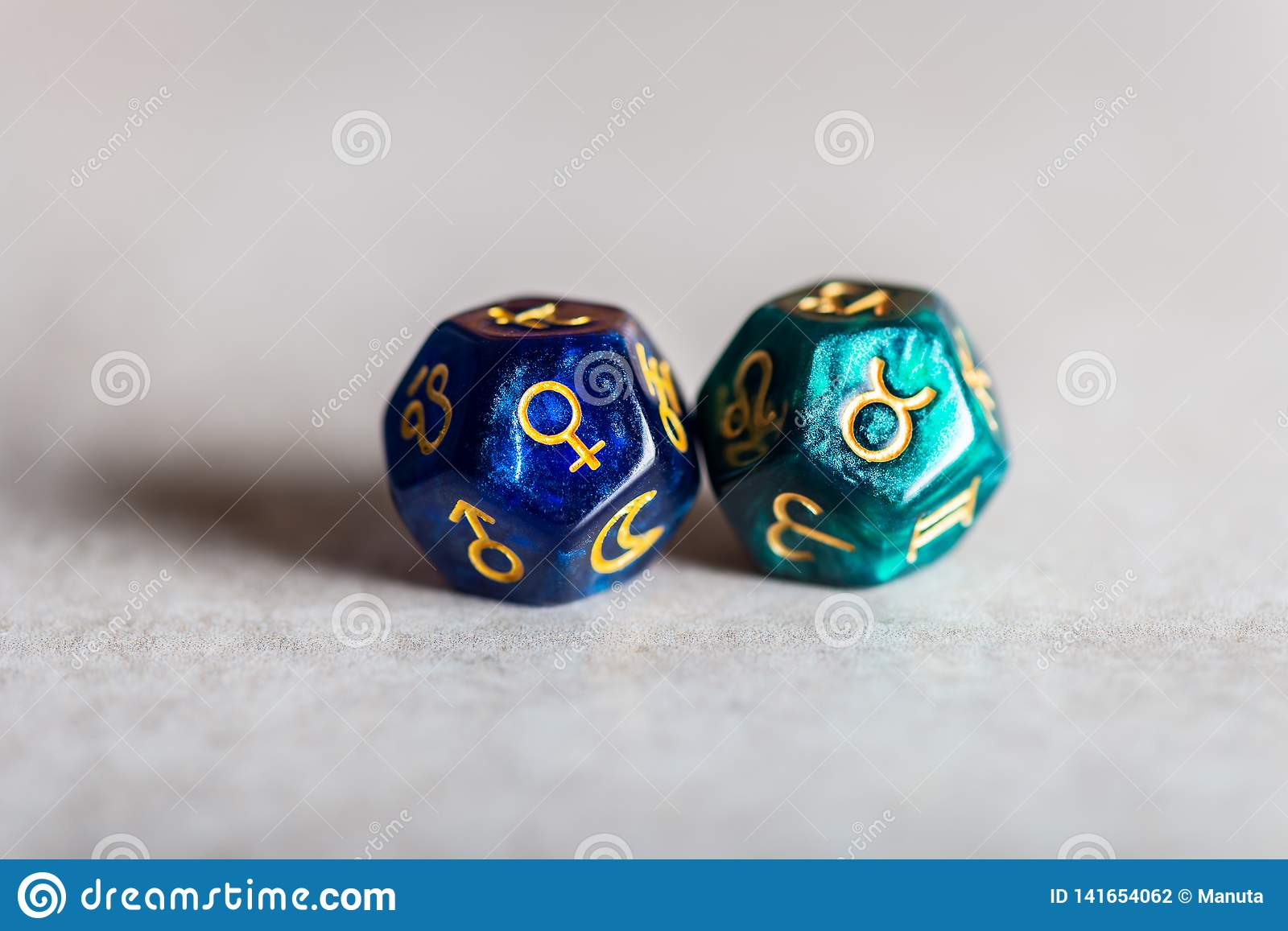 Astrology Dice with zodiac symbol of Taurus and its ruling planet Venus