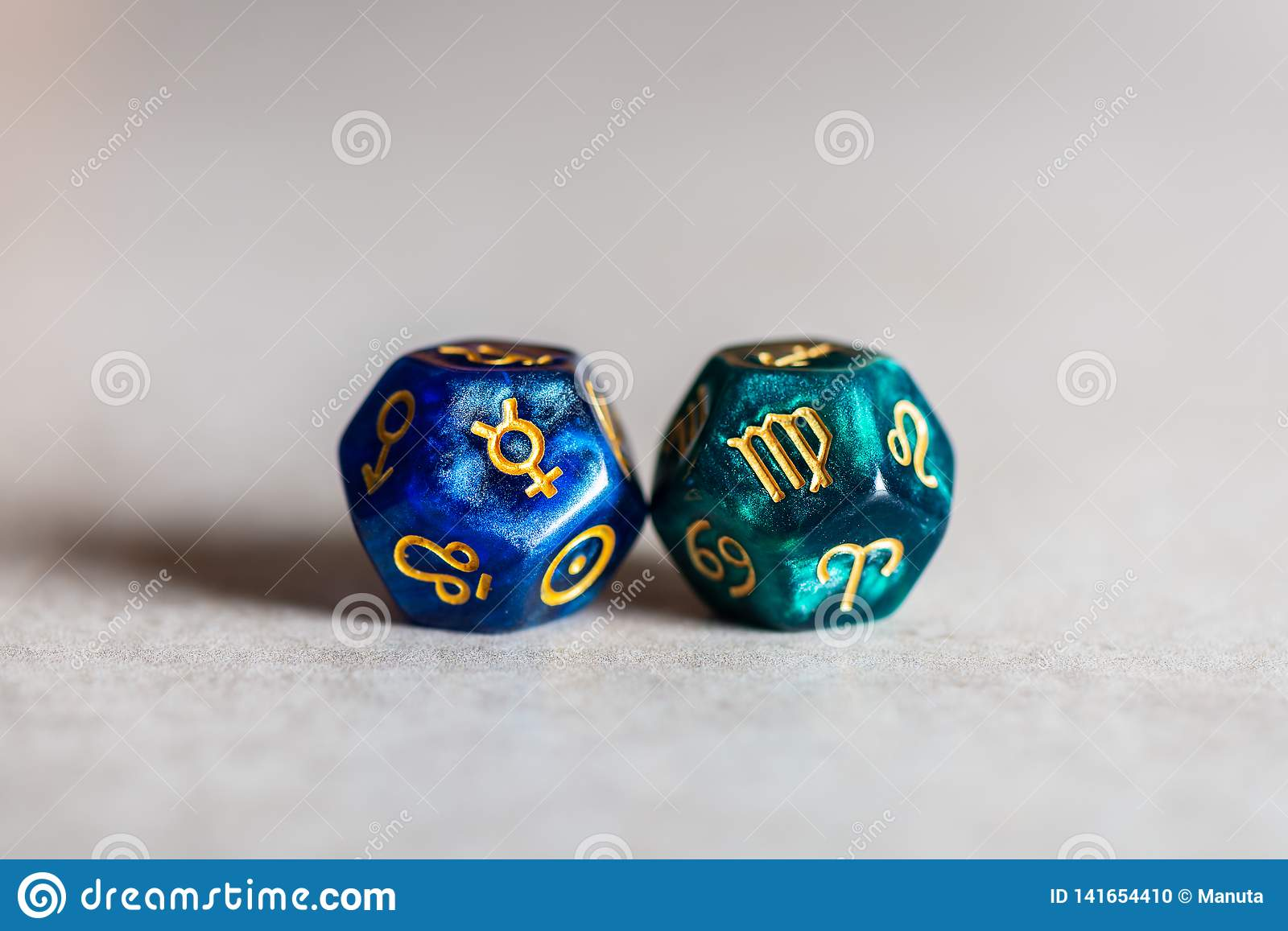 Astrology Dice with zodiac symbol of Virgo and its ruling planet Mercury