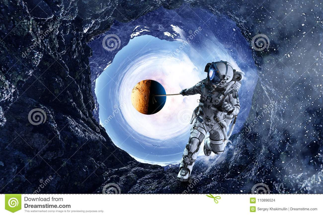 Fantasy image with spaceman catch planet. Mixed media