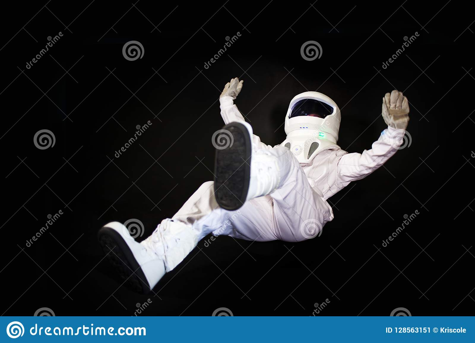 Astronaut In Space, In Zero Gravity On Black Background  Stock Image