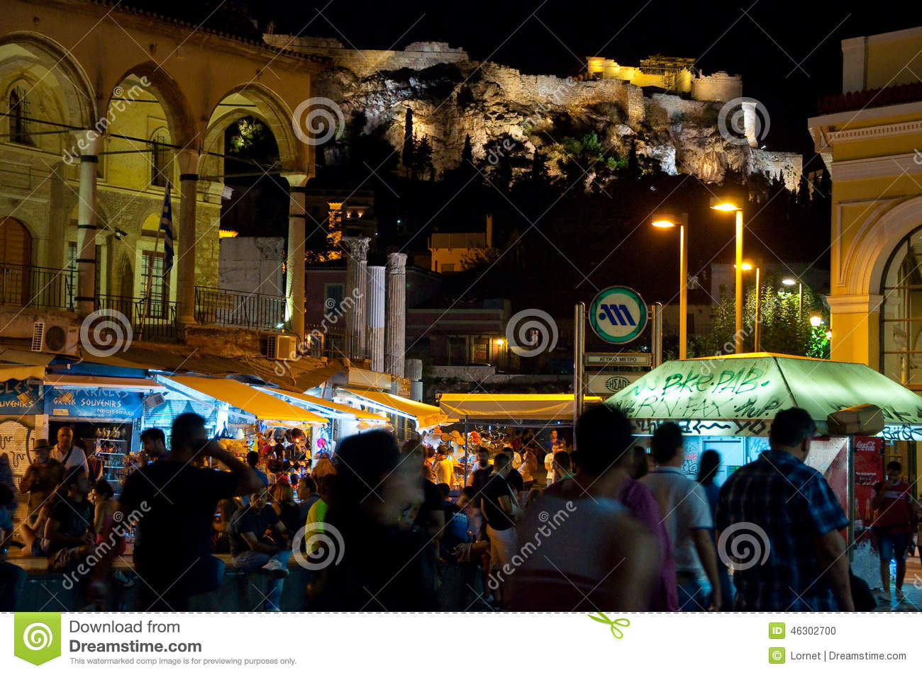 ATHENS-AUGUST 22: Nightlife on Monastiraki Square with Acropolis of Athens on the background on August 22, 2014 in Athens