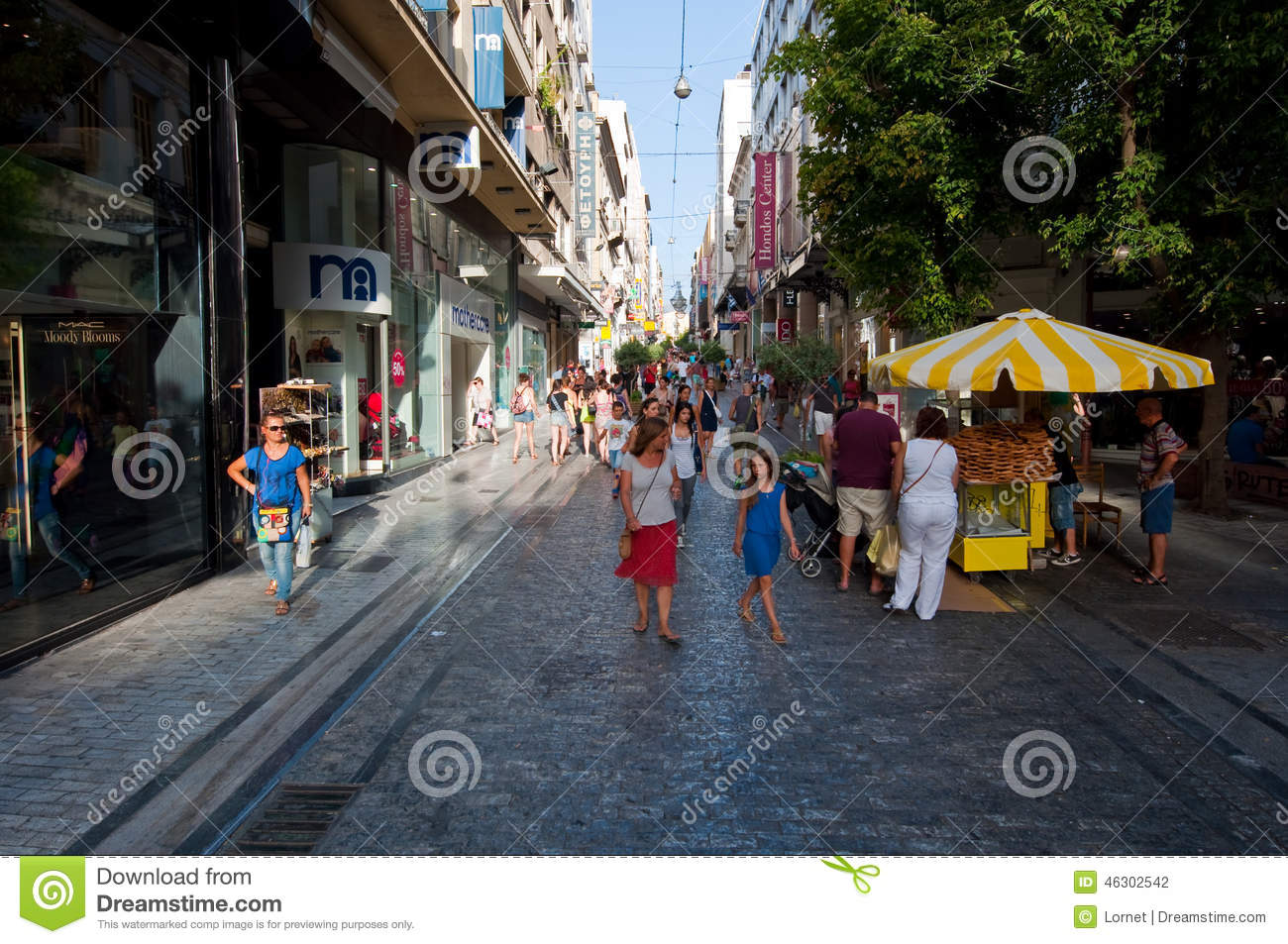 ATHENS-AUGUST 22: Shopping on Ermou Street with crowd of people on August 22, 2014 in Athens, Greece.