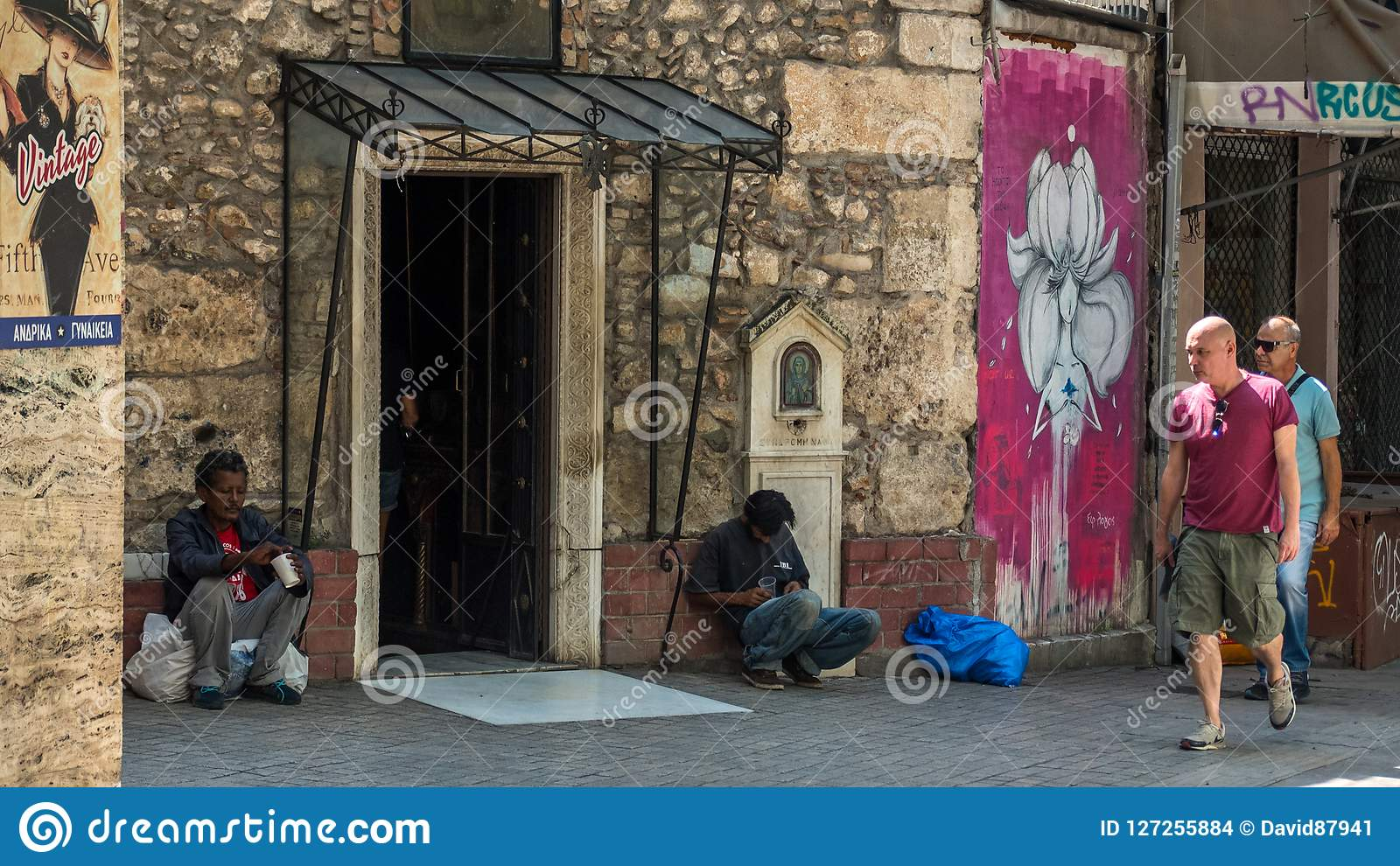 Athens Greece/August 17, 2018: Two homeless men in Athens