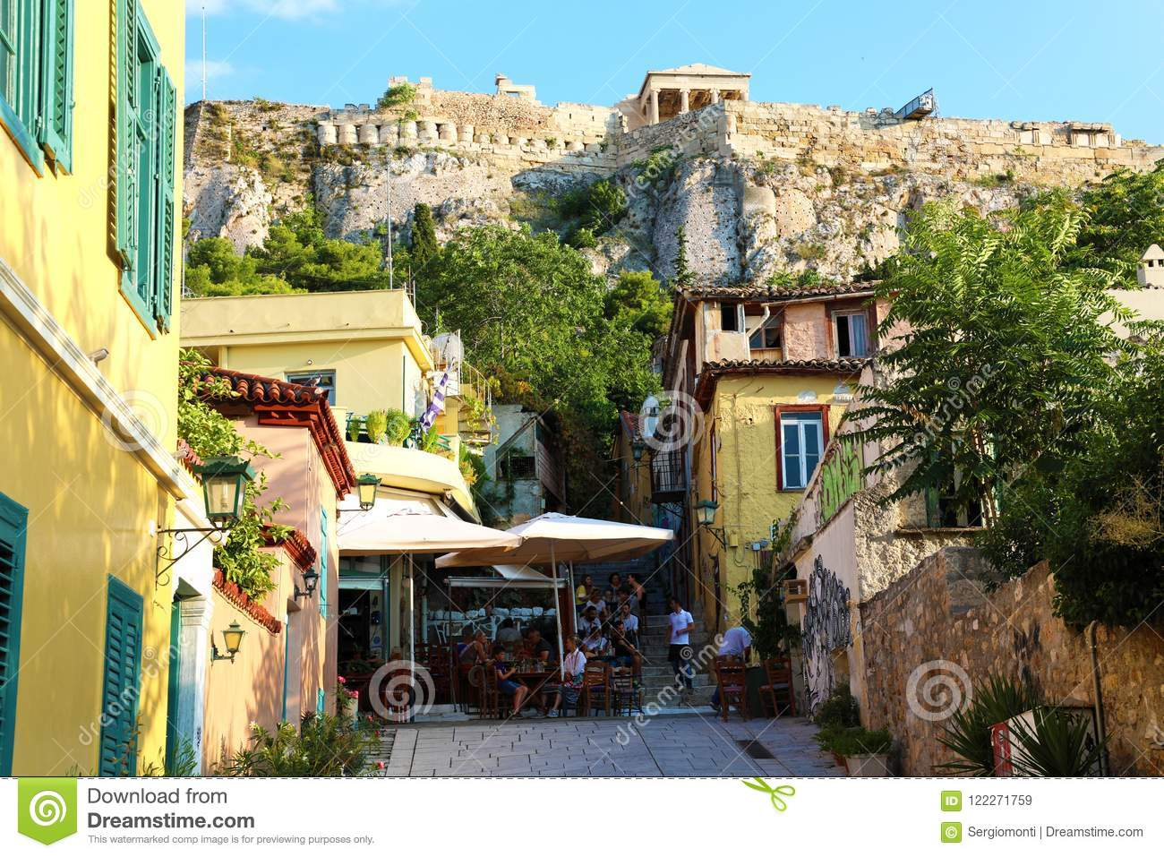 ATHENS, GREECE - JULY 18, 2018: cozy greek street with monuments and temples, Athens, Greece