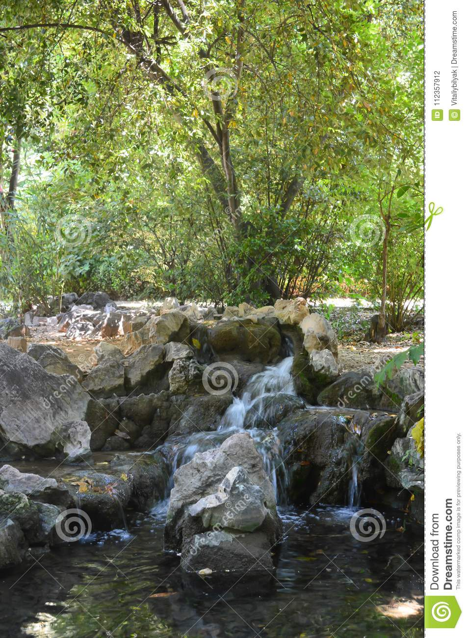 Small Waterfall in National Garden in Athens, Greece on June 23, 2017.