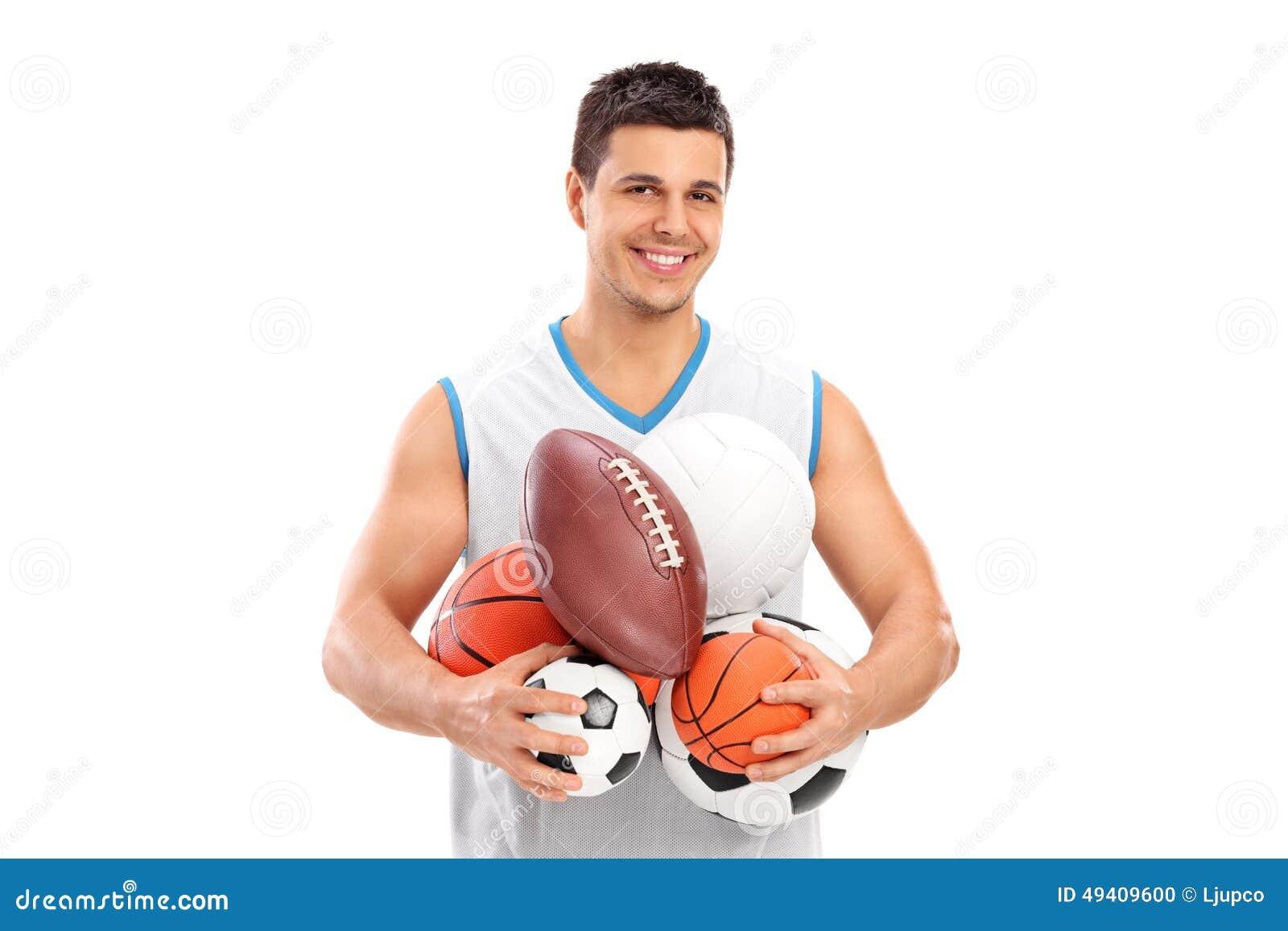 Download Athlet, Der Ein Bündel Verschiedene Arten Von Bällen Hält Stockfoto - Bild von holding, schauen: 49409600