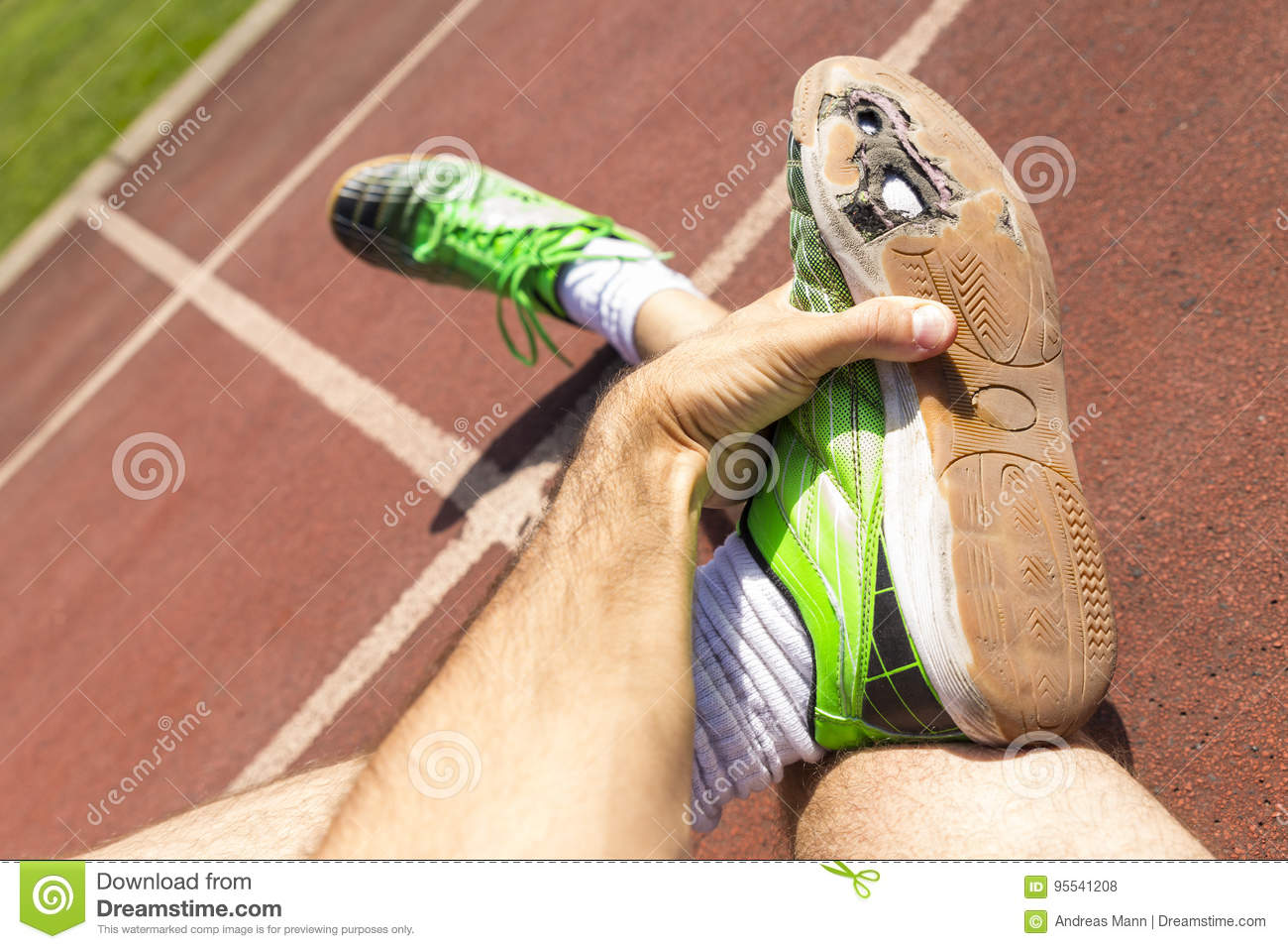 Athlete With Broken Green Running Shoes Stock Photo ...