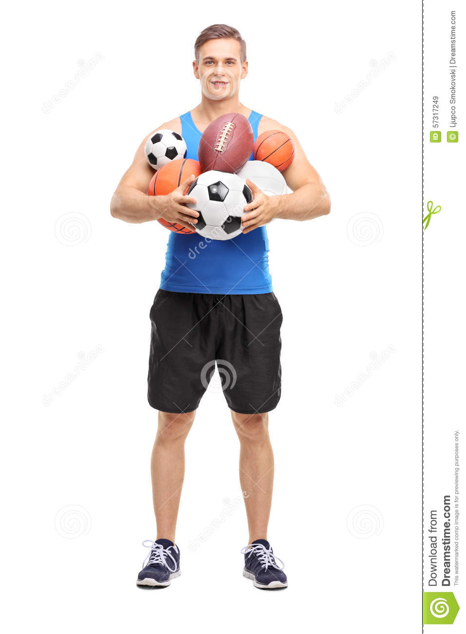 Athlete holding a bunch of different sports balls