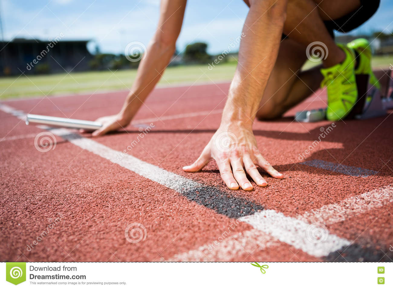 Athlete Ready To Start The Relay Race Stock Image