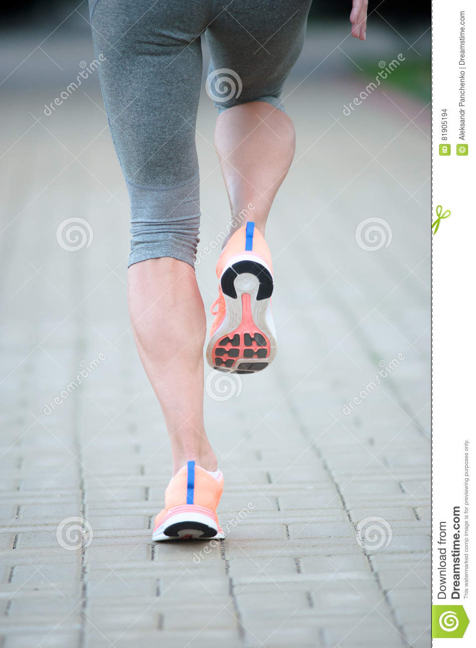 Athlete runner feet running on road closeup on shoe. woman fitness jog workout wellness concept.
