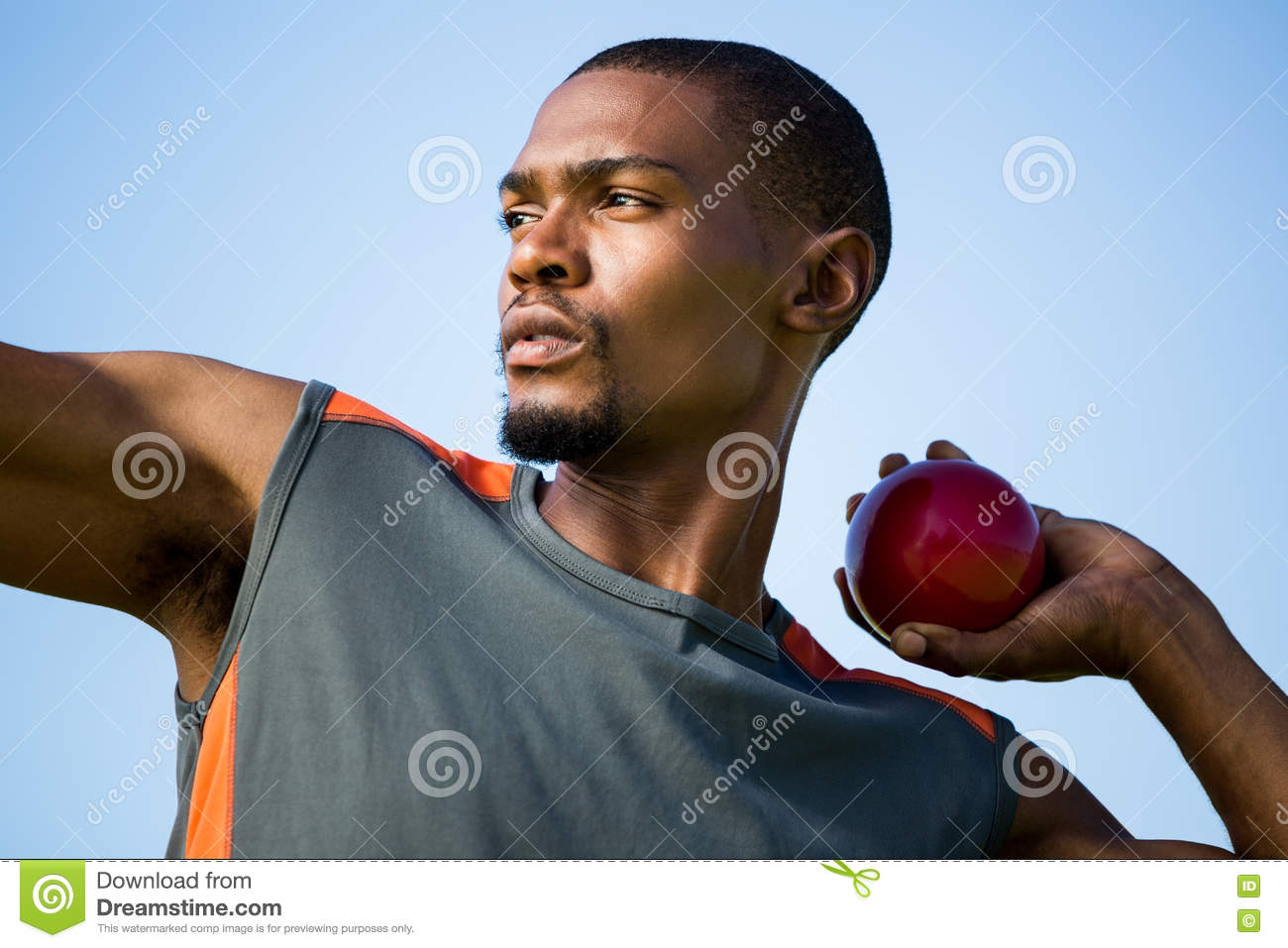Athlete about to throw shot put ball