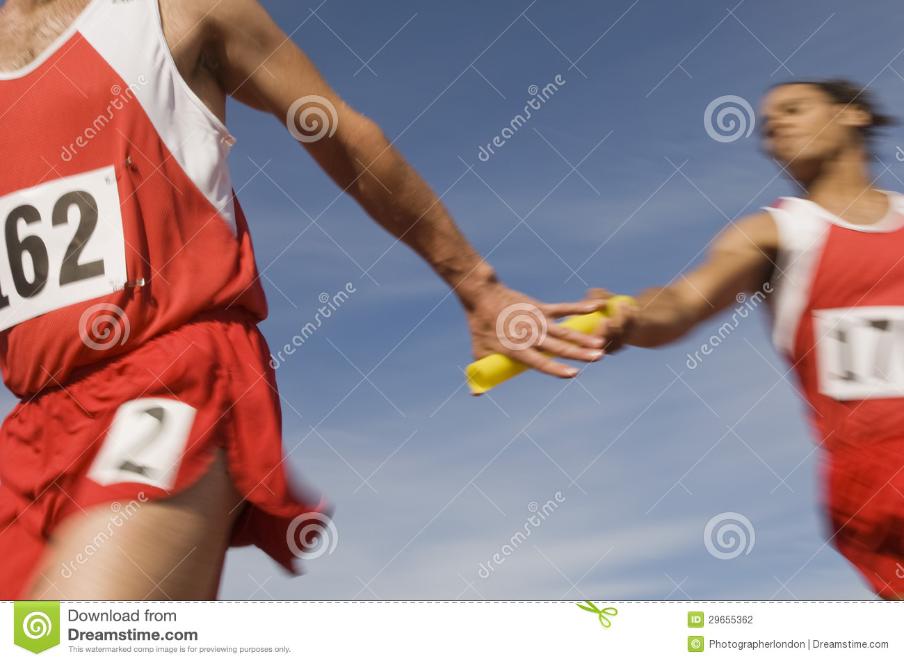 Athletes Passing Baton In Relay Race