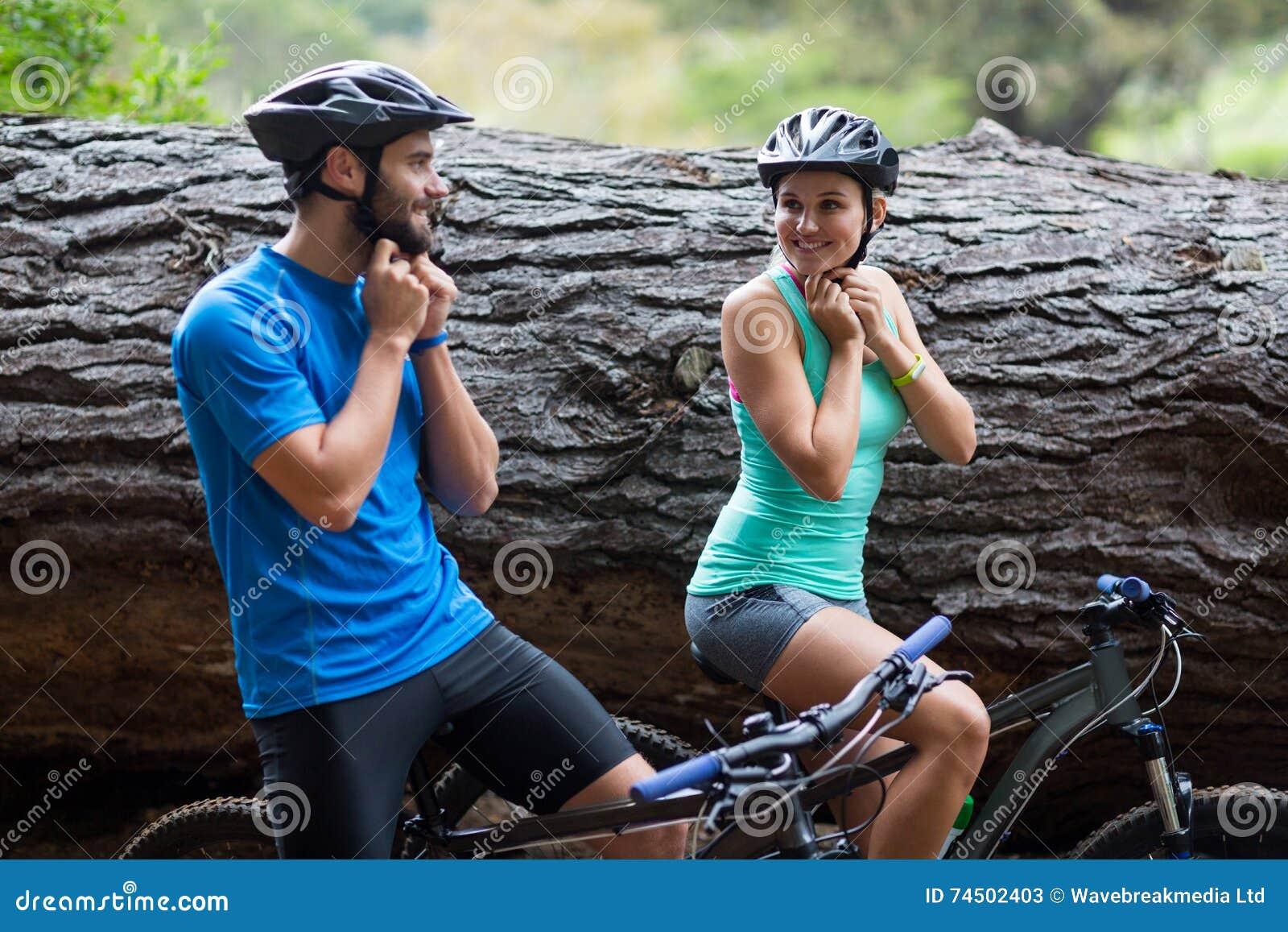 Athletic Couple Wearing Bicycle Helmet Stock Image