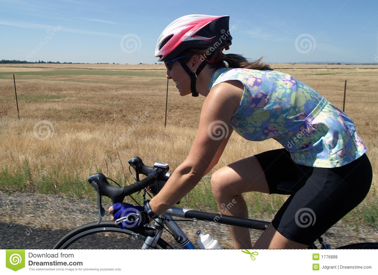 Athletic Female Road Cyclist Stock Photo