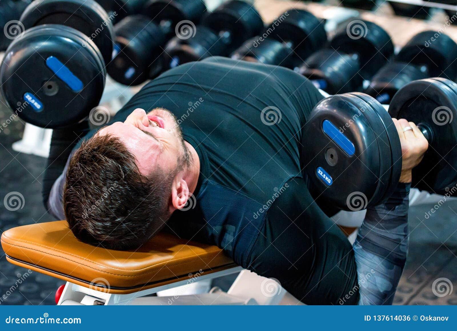 Muscular Bodybuilder Bench Press Workout In Modern Gym Stock