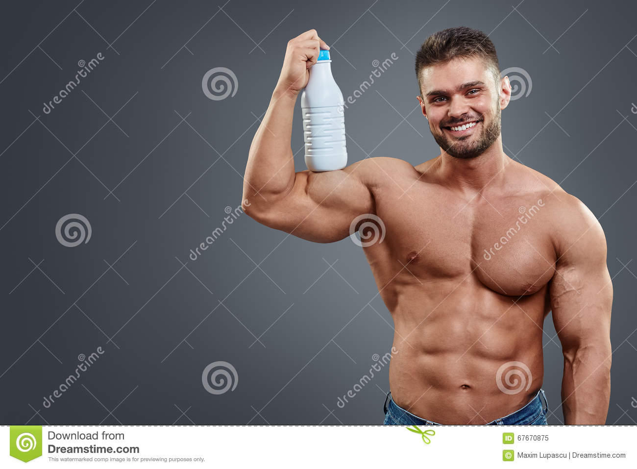 Athletic Man Fitness Model holding bottle