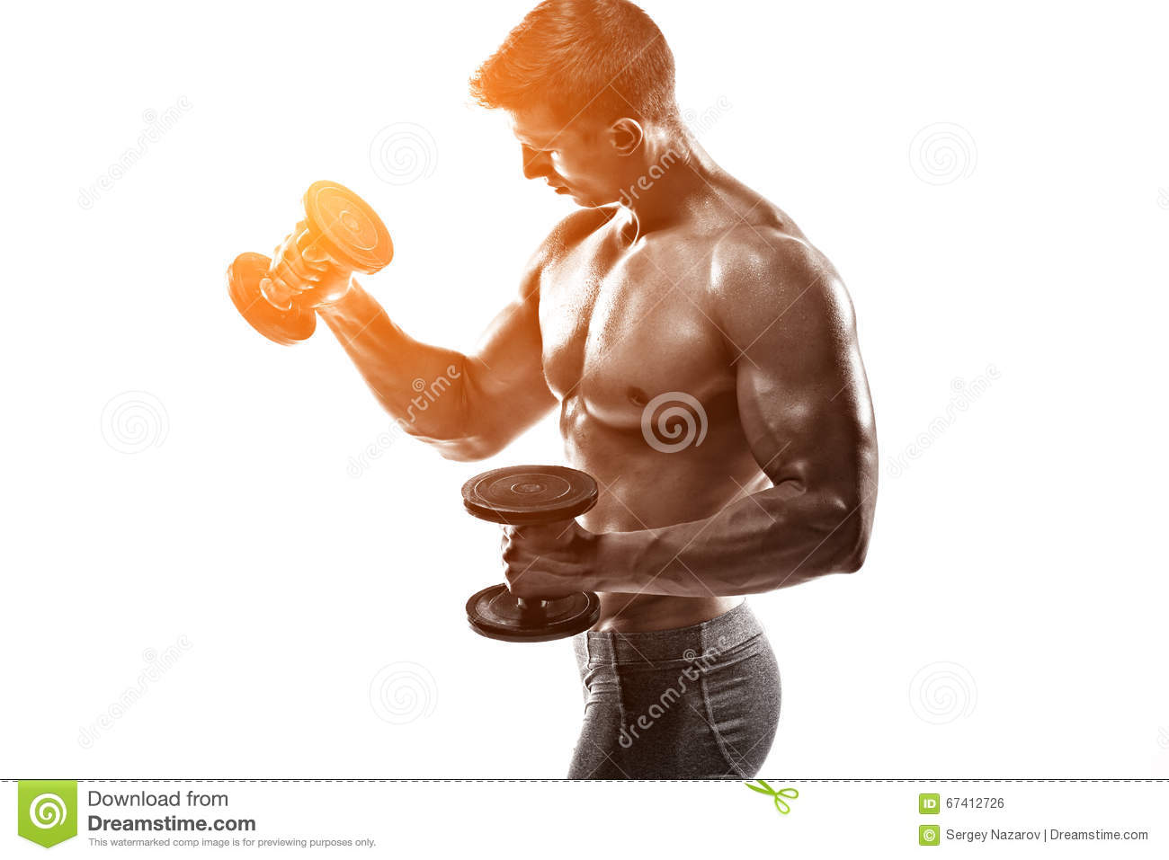 Attractive Muscular Man Is Posing With Dumbbell. Fitness