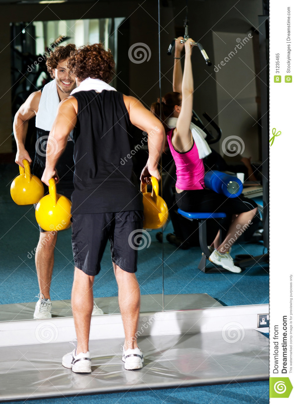 Athletic People Working Out With Equipments Royalty Free