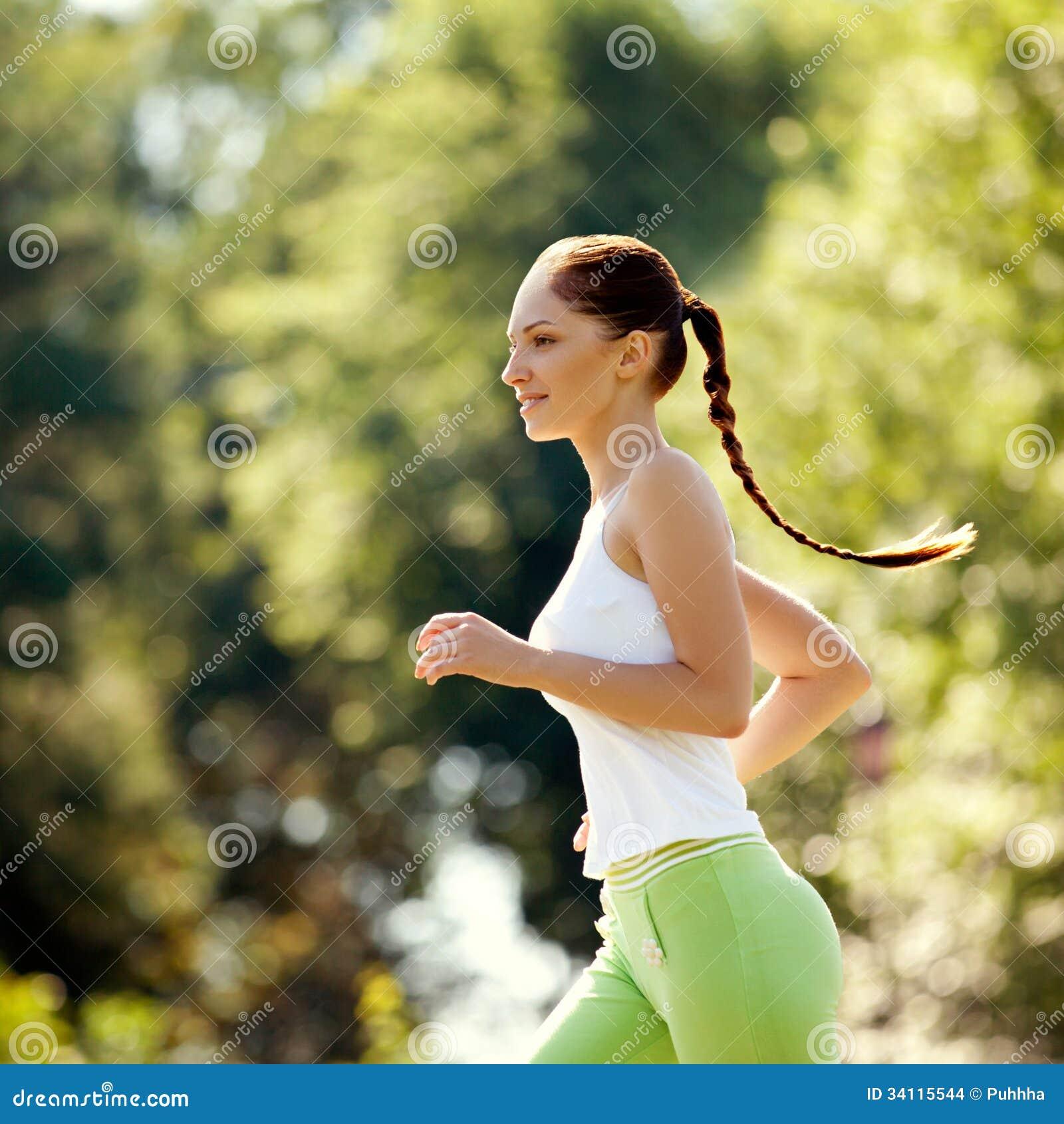 Athletic Runner Training In A Park For Marathon. Fitness Girl Ru Stock ...