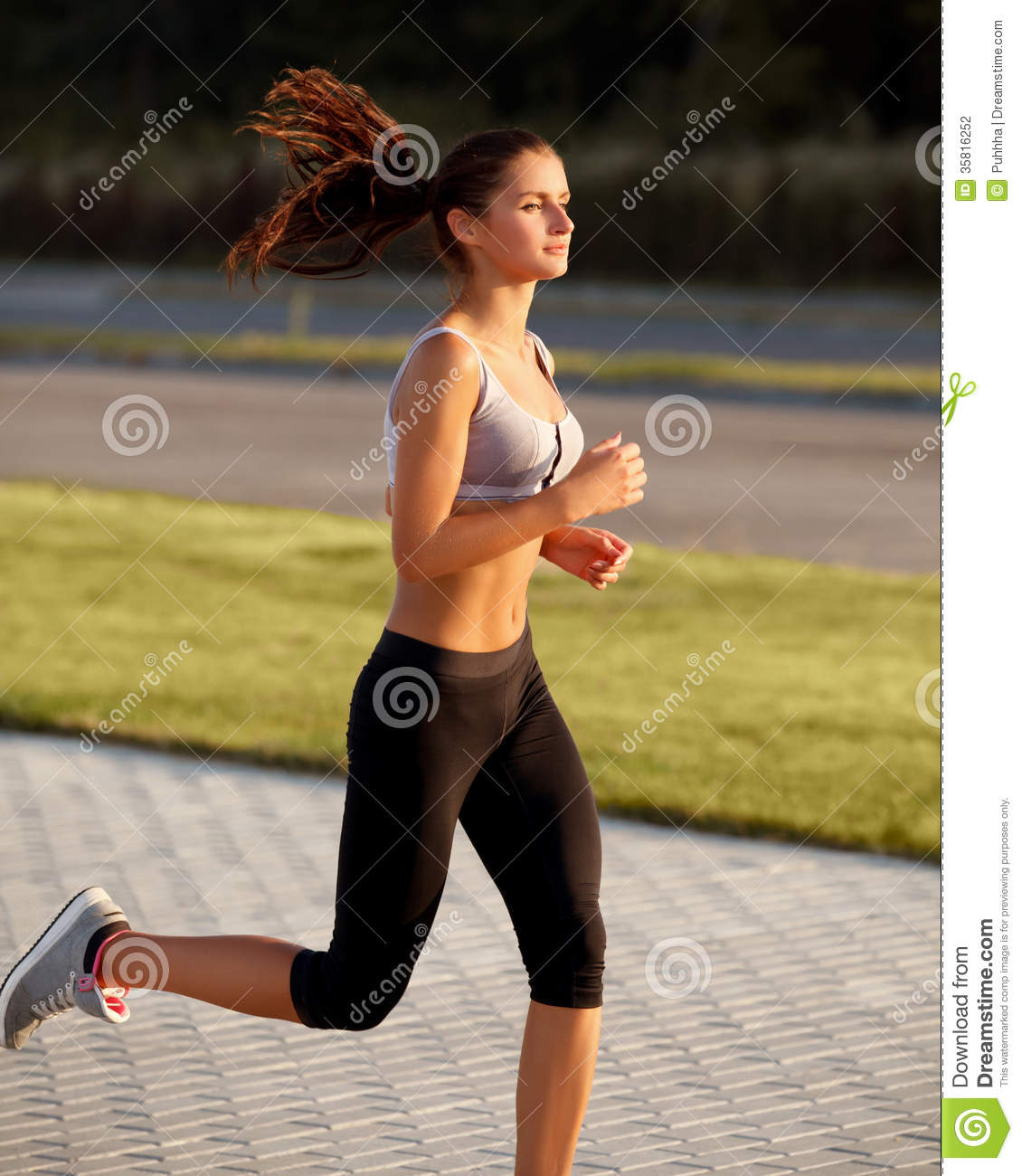 Athletic Runner Training in a park for marathon  Fitness Girl Running    Hot Girl Marathon Runner