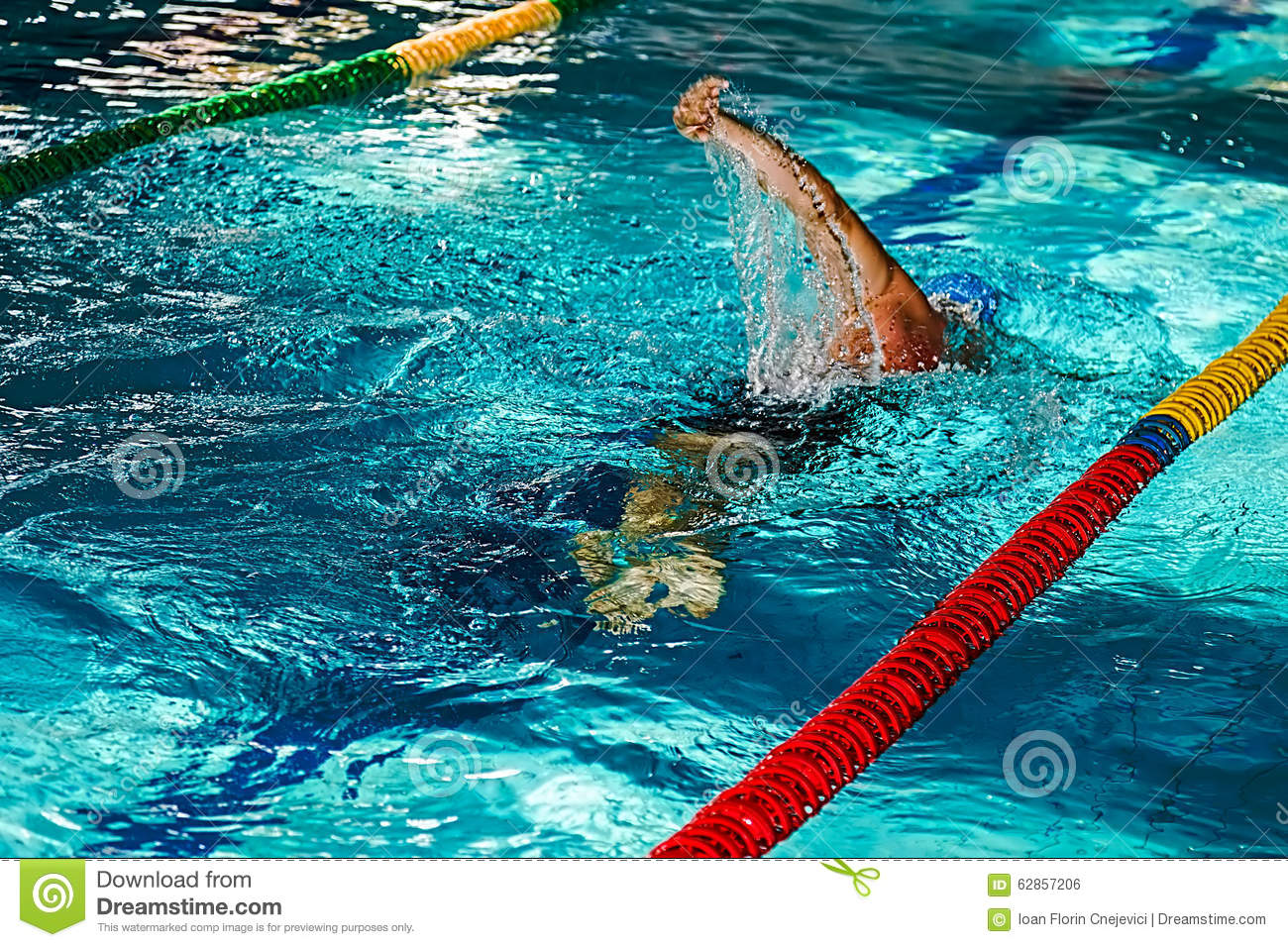 Swimming Pool Action : Athletic swimmer in action stock photo image