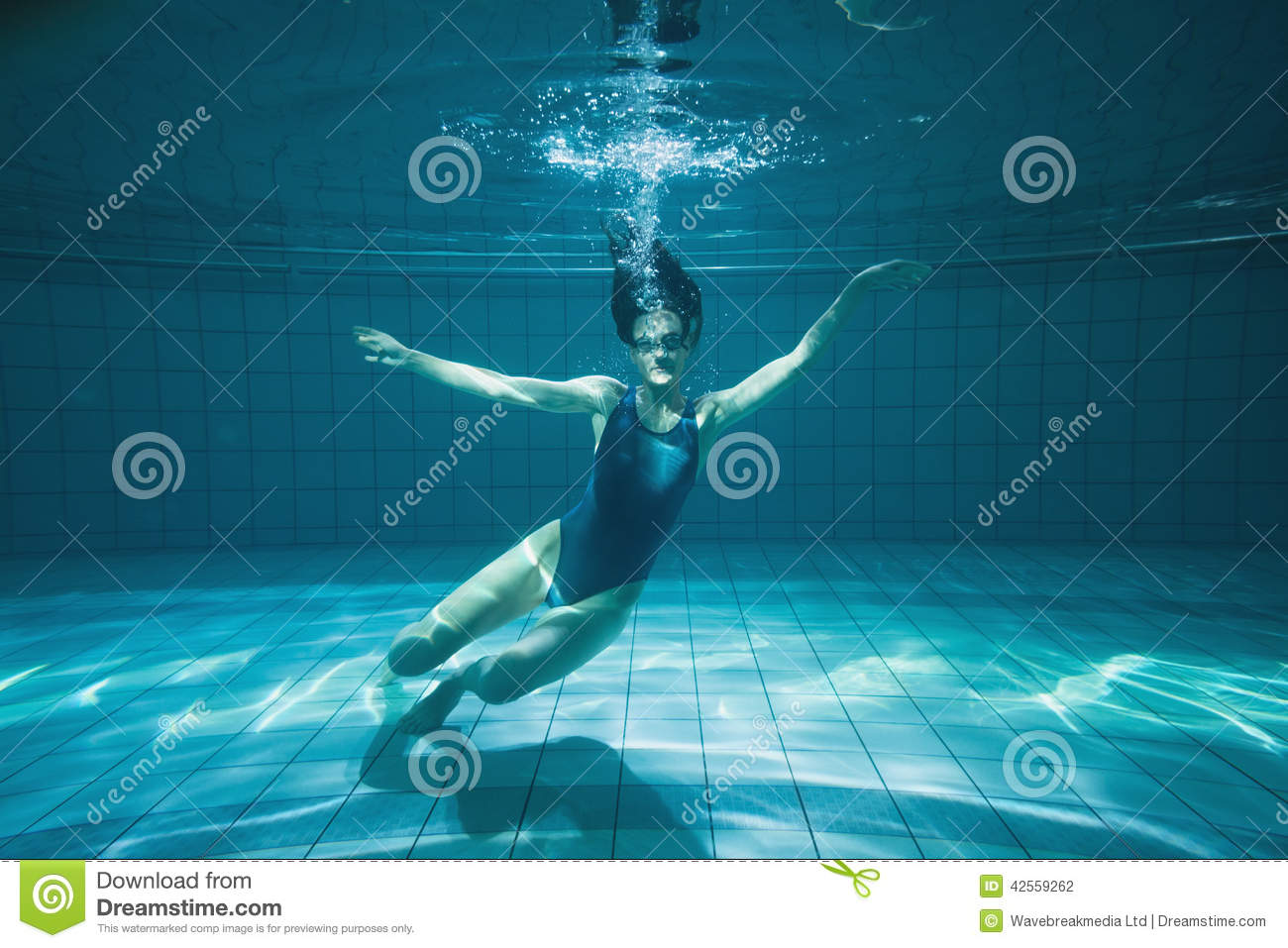 Athletic Swimmer Smiling At Camera Underwater Stock Photo Image 42559262
