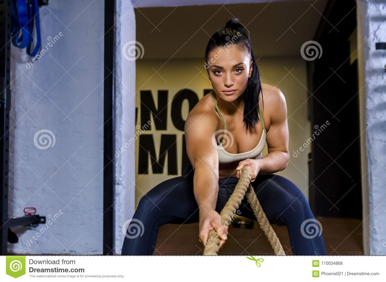 Athletic Woman In Action, Pulling Grope Stock Photo