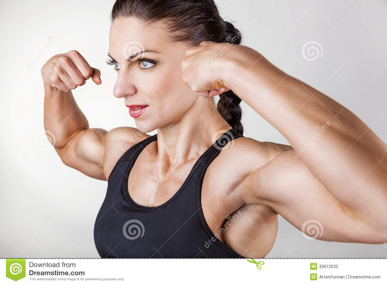 beautiful athletic woman showing biceps on white background