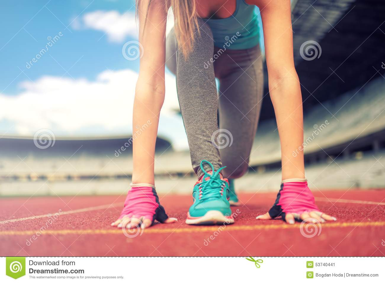 athletic woman going for a jog or run at running track healthy
