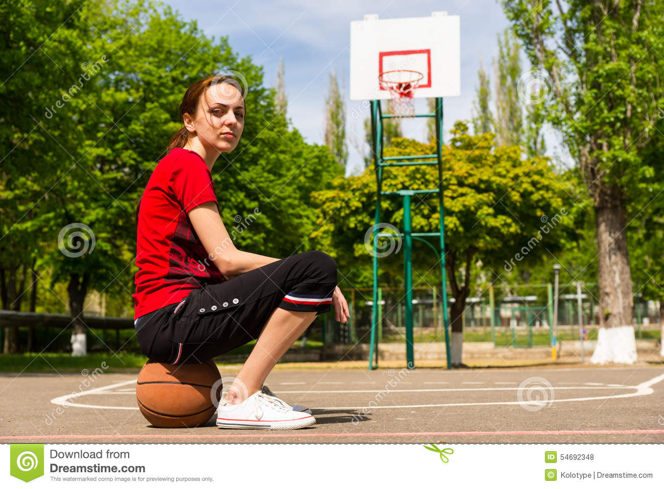 athletic woman sitting on basketball on court stock photo free clipart basketball hoop clipart basketball hoop