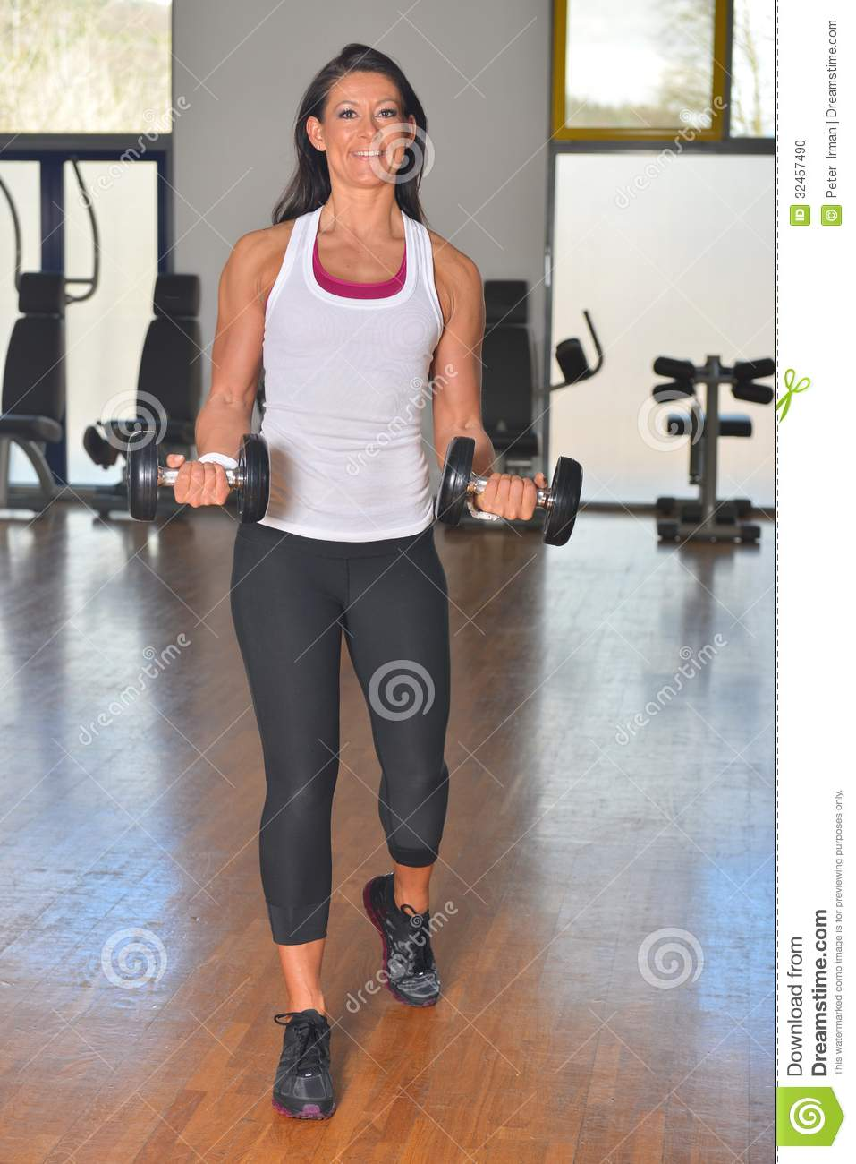 Athletic young lady doing workout in fitness studio stock for Lady fitness